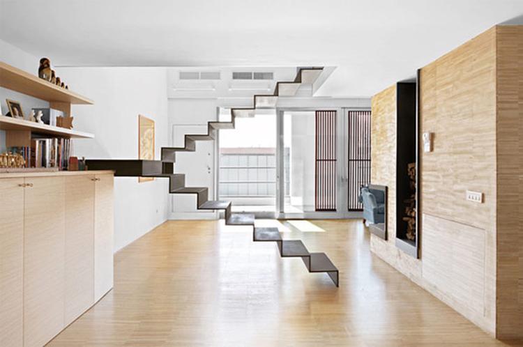 Deze minimalistische trap is een blikvanger in je woonkamer foto