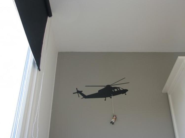 zandkleur Zaterdag van Histor. Muursticker met helikopter. Foto ...