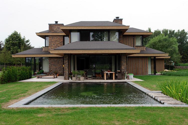 Mooi huis mooie vijver strakke vormen foto geplaatst door