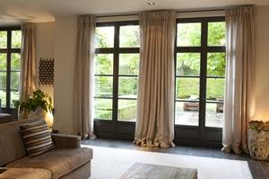 Mooie warme kleuren en rustig.......... Heerlijke woonkamer.... Foto ...