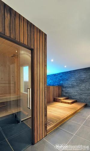 https://cdn3.welke.nl/cache/resize/300/auto/photo/23/02/34/zwarte-leisteen-in-badkamer-met-hout-sauna-en-badkamermeubel.1413101666-van-DAB.jpeg